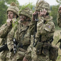 British Army reservists applying camouflage during training